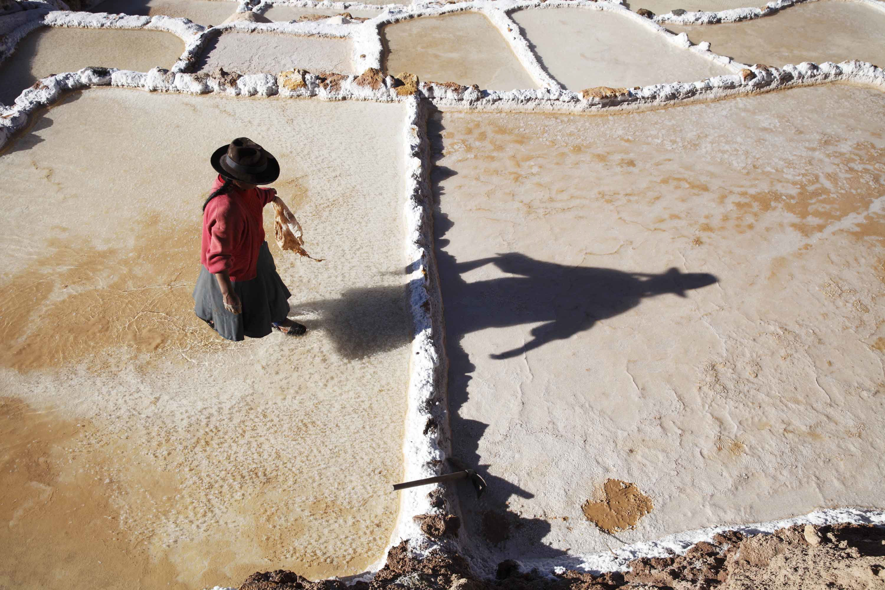 Salt making on the Inca made terraces of Salinas de Maras
